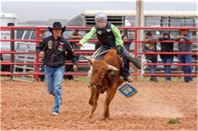 someone riding a bull